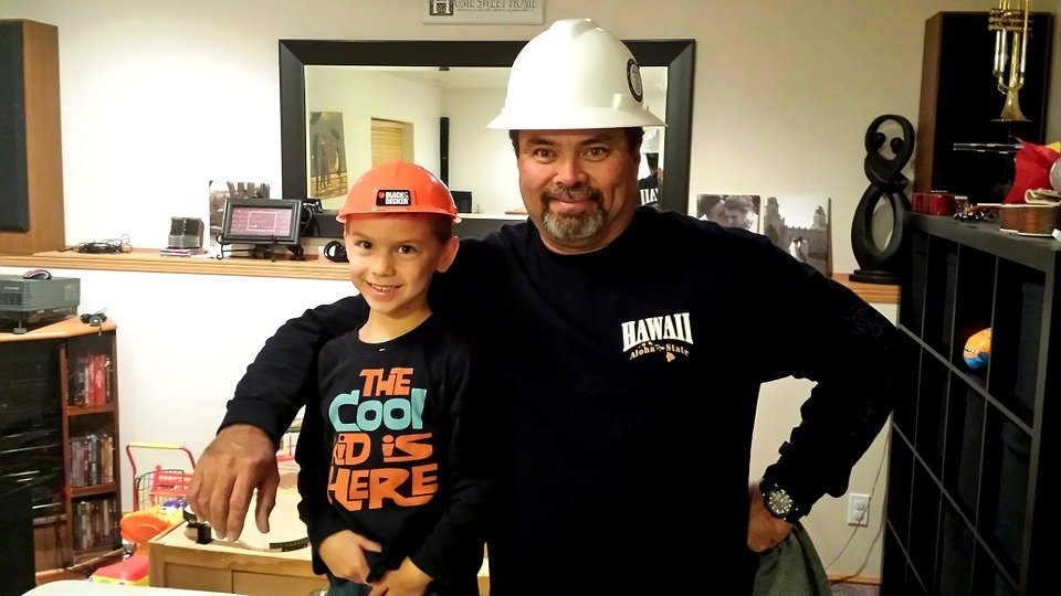 A Construction Worker with His Son